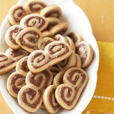 A hint of hazelnut takes these rolled-dough palmiers beyond typical chocolate cookies. FInd more cookie recipes here: http://www.bhg.com/christmas/cookies/christmas-cookies/?socsrc=bhgpin100314chocolatepalmiers&page=27