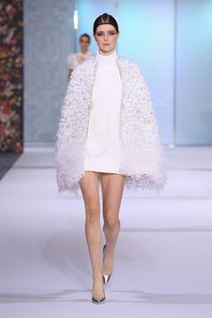 Off-white silk crêpe mini shift dress with braided neckline and cocoon cape, hand embroidered with crystals, glass beads, mink pom poms and ostrich    feathers.Fashion Friday: Ralph and Russo Autumn/Winter 2016-2017   http://brideandbreakfast.ph/2016/10/21/ralph-and-russo-aw-16-17/