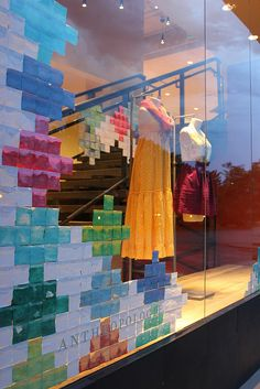 Post it note window display to make a quilt-like appearance creeping in on the sides
