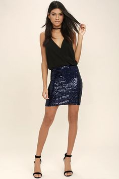 The Love Me Now Navy Blue Sequin Mini Skirt is the perfect amount of sparkle! Shimmering sequins shape this chic mini skirt, with a high waistline, and leg-baring length. Exposed metallic back zipper.