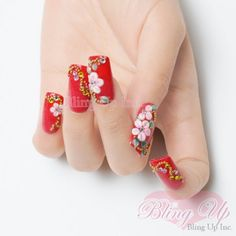 Pink 3D nail art flowers with little green leaves are subtle and beautiful as they sit atop the luscious red nail tips. Gold metal beads and glitter bring bling the nail art with the additional genuine Swarovski crystals.Nail Polish: OPIRhinestone: SwarovskiPlease readTHIS NOTEwhen ordering your nail tip set for sizing information.