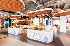 The Amsterdam office features stroopwafel ceiling tiles. Office Interior Design, Office Interiors, Interior Design Inspiration, Office Designs, Design Ideas, Office Ideas, Corporate Interiors, Restaurant Interiors, Food Design