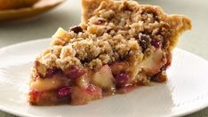 Tart cranberries add a delicious twist to traditional apple pie.