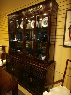 Heavily Carved China Cabinet In A Rosewood Finish Matching Dining Room Set With Eight