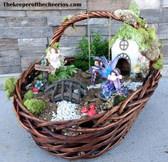 Easter Basket Fairy Garden Tired of the same old Easter baskets? This is a fun way to mix up the traditional Easter basket into something fun and different! Materials: Basket with handle (any kind will work, but a larger one gives more room for the items) Hot glue and glue gun Fine Glitter Hemp cording Jumbo Popsicle stick Brown craft paint and brush Fake moss and ground cover Small rocks (fish tank rocks work great) Artificial plants Plastic liner (black garbage bag works great) and dirt…
