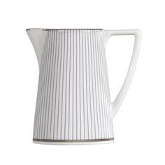 This Creamer is made from fine, white earthenware with a distinctive rippled 'pinstripe' design, decorated with contrasting bold, blue bands.