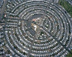 Very Unusual design for road layouts (The Urban Spiral). Could be used a maze like environment? Food for thought