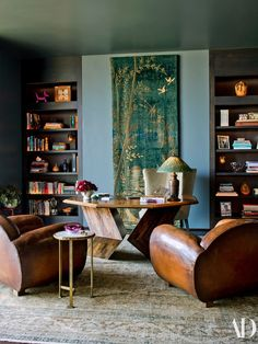 In Aniston's office, a pair of vintage leather club chairs face a desk by Don S. Shoemaker from JF Chen. Tiffany lamp.