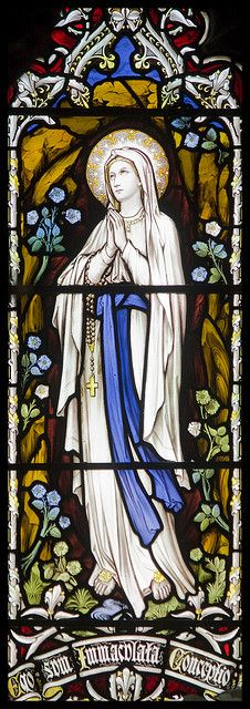 Our Lady is not Mary. Our Lady of Lourdes Stained Glass Window in Llandudno Catholic Church, Llandudno, Wales Stained Glass Church, Stained Glass Art, Stained Glass Windows, Stained Glass Tattoo, Blessed Mother Mary, Blessed Virgin Mary, Catholic Art, Religious Art, Roman Catholic