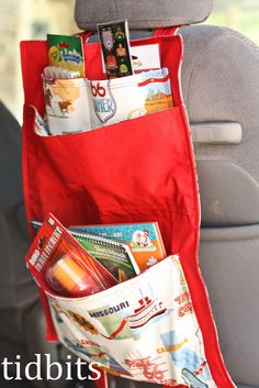 What a great idea for long holiday drives - an organiser for kid's toys that you can hang up in the car, and then fold up into a pretty bag to take with you.