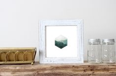Show off your style with this geometric art print. This print features a rustic landscape across abstract shapes and makes for a beautiful piece in a modern decor style.