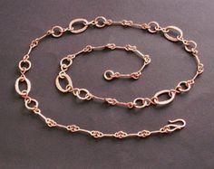 "This copper chain necklace is perfect for 7th wedding anniversary gift. It is handcrafted from copper and it is 36 long, with five 2 1/2"" ornamental segments, each containing two swirls and one oval link in the middle. Chain has light hammered texture and natural, warm and shiny finish. Here are my other chains: https://www.etsy.com/shop/copperryfields?section_id=13574276 It will be send in small, handmade, craft paper pillow box International Buyers please conv..."