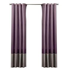 "Colorblocked curtain panel with grommets.     Product: Set of 2 curtain panels     Construction Material: 100% Polyester and metal   Color: Purple and gray    Features: Metal grommets slide onto curtain rod for installationFull lining provides extra insulation and privacy    Dimensions: 84"" H x 54"" W each  Note: Curtain rod not includedCleaning and Care: Dry clean only"