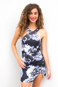 Little black dress features a blue and white floral pattern with a high neckline. Concealed zipper at the back. Double lined. Style it with a nude or black heel and a small burgundy bag for you next dinner date!