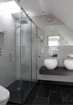 dark grey floors, lighter grey walls.  Could be something other than subway tiles on the wall.