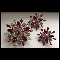 Sherman lotus brooch with matching earrings . Clear & fuchsia rhodium plated .