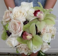 Virginia Roses with Green Cimbidium orchids and Purple Hydrangea designed by Lana with Fairbanks Florist.