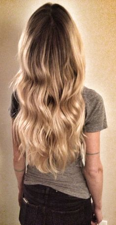 blond wavy hair / ombre / balayage / highlights / beach hair / hair color / line tattoo / ink /