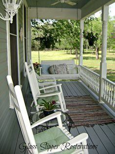My dream porch, especially if it wraps around the house!  Such a lovely spot. :)