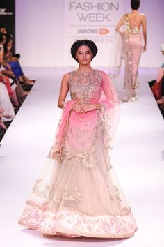 Indian wedding outfits from lakme fashion week. From Indian dresses to wedding lehengas see our designer favorites for your wedding day.