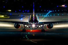 Twin jet at night taxi