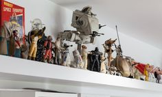 A very long and impressive floating shelf contains a mind-blowing collection of vinyl toy figurines from travels around the world.  Paula & Paul's Lively, London Home and Studio