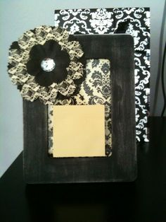 This post-it note holder is a great gift for co-workers at Christmas.  I used a 4X6 unfinished frame that I painted black and lightly distressed with sandpaper.  I decorated with scrapbook paper and paper flower!