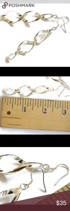 925 Sterling Silver DNA Strand Earrings A gorgeous set of solid 925 sterling silver DNA strand earrings. Great for a doctor, nurse, or physicians assistant. Also good for med/nursing students. See pics for measurement and 925 hallmark. nejd Jewelry Earrings