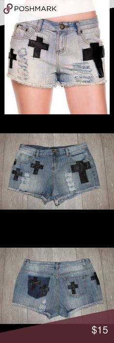 Distressed Denim Shorts Rock out in these cool mid rise denim shorts with faux leather cross shaped patches. They have a short hemline with a zipper and button closure.  85% cotton 15% polyester.  I've washed them but they have never been worn. mine Shorts Jean Shorts
