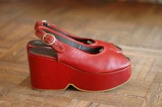 vintage 1970 shoes / 70s red leather platforms / size 8.5. $100.00, via Etsy. DUDE.