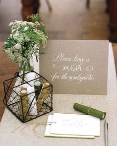 In lieu of a guest book, invite loved ones to leave their best wishes on paper scrolls.