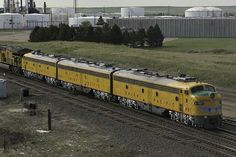 Union Pacific moved their E-units; 951 E9A, 963B E9B and 949 E9A, out of Cheyenne, WY, to Council Bluffs, Iowa, Sunday, June 12, 2016. They will attend The College World Series that starts on Saturday, June 18, 2016 at TD Ameritrade Park Omaha, Nebraska. UP 951 was passing the HollyFrontier Refining operation.  ©2016 Chip