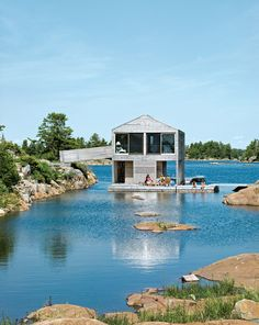 Floating House with an Integrated Boathouse and Dock