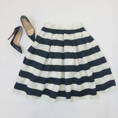 """Black & White Striped Midi Skirt Amazing striped satin midi skirt with banded waist and pleats below. Falls below knee and sits high on waist. Fully lined. Never worn. New without tags (was not sold with tags). Size tag says XL but best fits a L. Waist is 15"""" across, taken while laying flat. Down from $65. My price is firm, I'm already losing money on an brand new item I never wore. No trades. First come, first served. Happy to bundle! Thank you! :) Tara Lynn's Boutique Skirts Midi"""