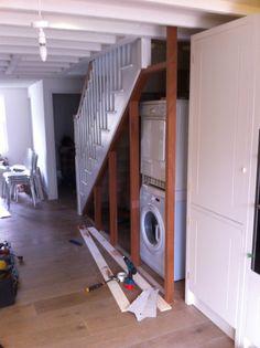Washing machine under stairs