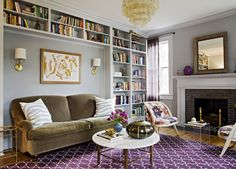 Lovely grey lounge with purple rug and elegant fireplace - a perfect gray: my new gray favorite....