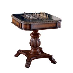 Play a variety of games on this stylish hand-carved pedestal table. The design evokes a traditional club room-feel with a reversible chess/backgammon board and a handcrafted stone veneer top.
