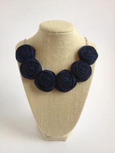 Navy blue rosette bib necklace