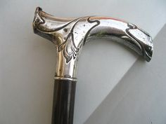 German Turn of the Century Silver Walking Stick. this is a walking stick with silver handle made in Germany at the beginning of the 20th century. The silver handle has 'Art Nouveau' floral motifs and an engraved monogram (unidentified). It is hallmarked with 'crescent and crown' and '800' (800/1000 silver).