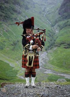 portrait of scottish bagpiper region of highlands scotland great britain stock photo