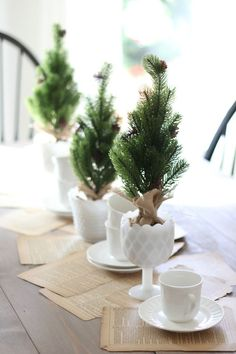 Colonial Christmas Dining Room and Christmas Tablescape inspiration featuring milk glass and old book pages. Christmas Table Centerpieces, Christmas Table Settings, Christmas Tablescapes, Christmas Decorations, Holiday Tables, Holiday Decorating, Table Decorations, Simple Christmas, Christmas Home
