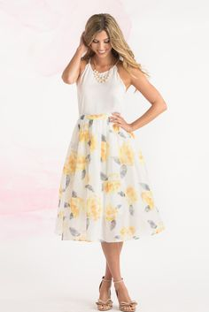 Feminine and floral meets a classic midi length! We're loving this watercolor rose print that just embodies Spring! Pair this...