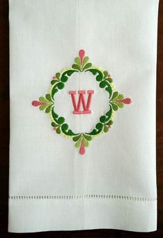 Monogrammed guest towel. Spring colors on white cotton/linen towel.