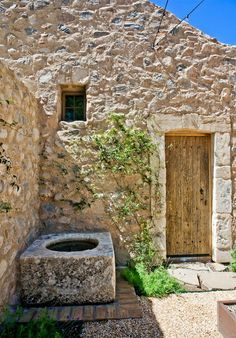This Tuscan style jewel is actually a new home, designed & built to detailed perfection. Note the antique stone basin...