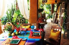 The colorful table and the alfresco setting reminds me of summer vacations...