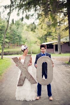 bride and groom with XO letters // photo by Clayton Austin // http://ruffledblog.com/new-york-lakeside-wedding