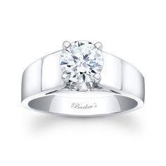Solitaire Engagement Ring - 2304LW - Bold, classic and contemporary in design this solitaire engagement ring makes a strong statement of confidence and strength.  A round center diamond is prong set just above the broad cathedral shoulders and a bright polished finish adds a clean sophisticated look.    Also available in yellow gold, 18k and Platinum.