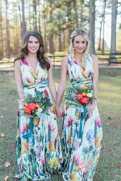 Colorful bridesmaid floor length floral dresses and bright bouquets