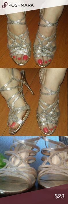 Silver and gold stilettos Silver and light gold rope style elegant stilettos in worn but great condition. The snakeskin style heel does a great job hiding any wear. Caparros Shoes Heels