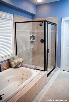 This master bath features a large walk-in shower and soaking tub! Plan #333 - The Tamassee. http://www.dongardner.com/plan_details.aspx?pid=280. #Shower #Tub #MasterBath